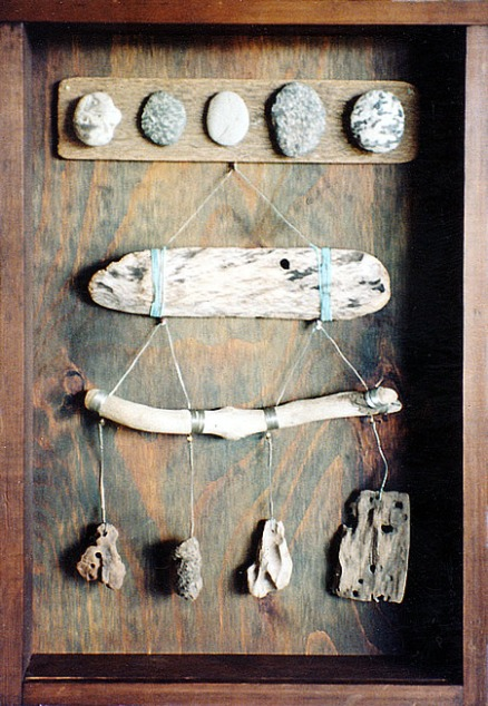 Different drift wood, wire and stones.