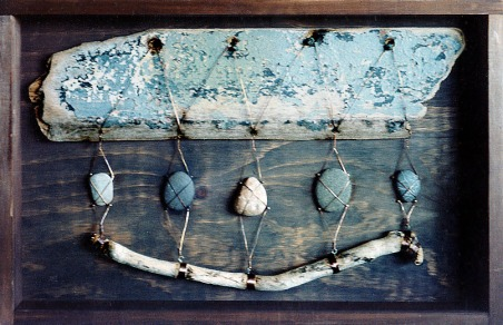 Drift wood, wire and stones