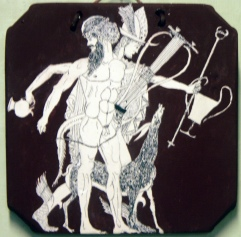 Hermes wearing a winged hat and sandles, carries a wine jar and drinking cup and is accompanied by a satyr who is carrying a lyre.