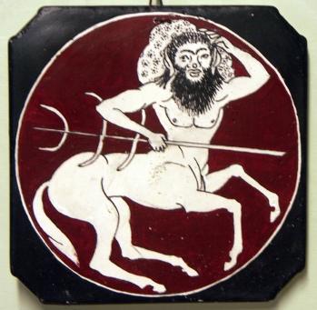 A centaur shouldering a rock, signed Printias, ca. 520 B.C.